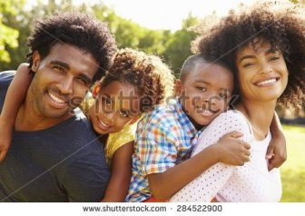 stock-photo-parents-giving-children-piggyback-ride-in-garden-284522900