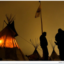 Matt Black Eagle Man middle, a member of the Long Plain First Nation chats with friends outside his teepee at Oceti Sakowin Camp on the edge of the Standing Rock Sioux Reservation on Dec