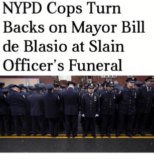 nypd-cops-turn-backs-on-mayor-bill-de-blasio-at-25092147