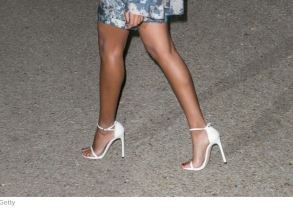 Solange wearing German Shoe Designer Stuart Weitzman nudist Sandal