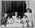 Children of slave master posed on porch, Georgia mulattoes