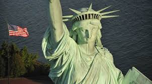 Lady Liberty with American Flag in the Background