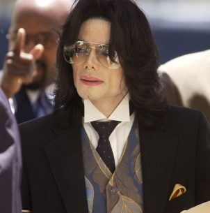 SANTA MARIA, CA - JUNE 1: Michael Jackson arrives for his child molestation trial on at the Santa Barbara County Courthouse arrives for his child molestation trial on at the Santa Barbara County Courthouse June 1, 2005 in Santa Maria, California. Jackson is charged in a 10-count indictment with molesting a boy, plying him with liquor and conspiring to commit child abduction, false imprisonment and extortion. (Photo by Aaron Lambert-Pool/Getty Images)